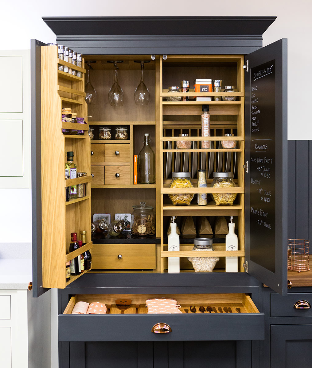 A SHAKER PANTRY INCORPORATING A TRADITIONAL BLACKBOARD AND POCKET SHELVES FOR SPICES
