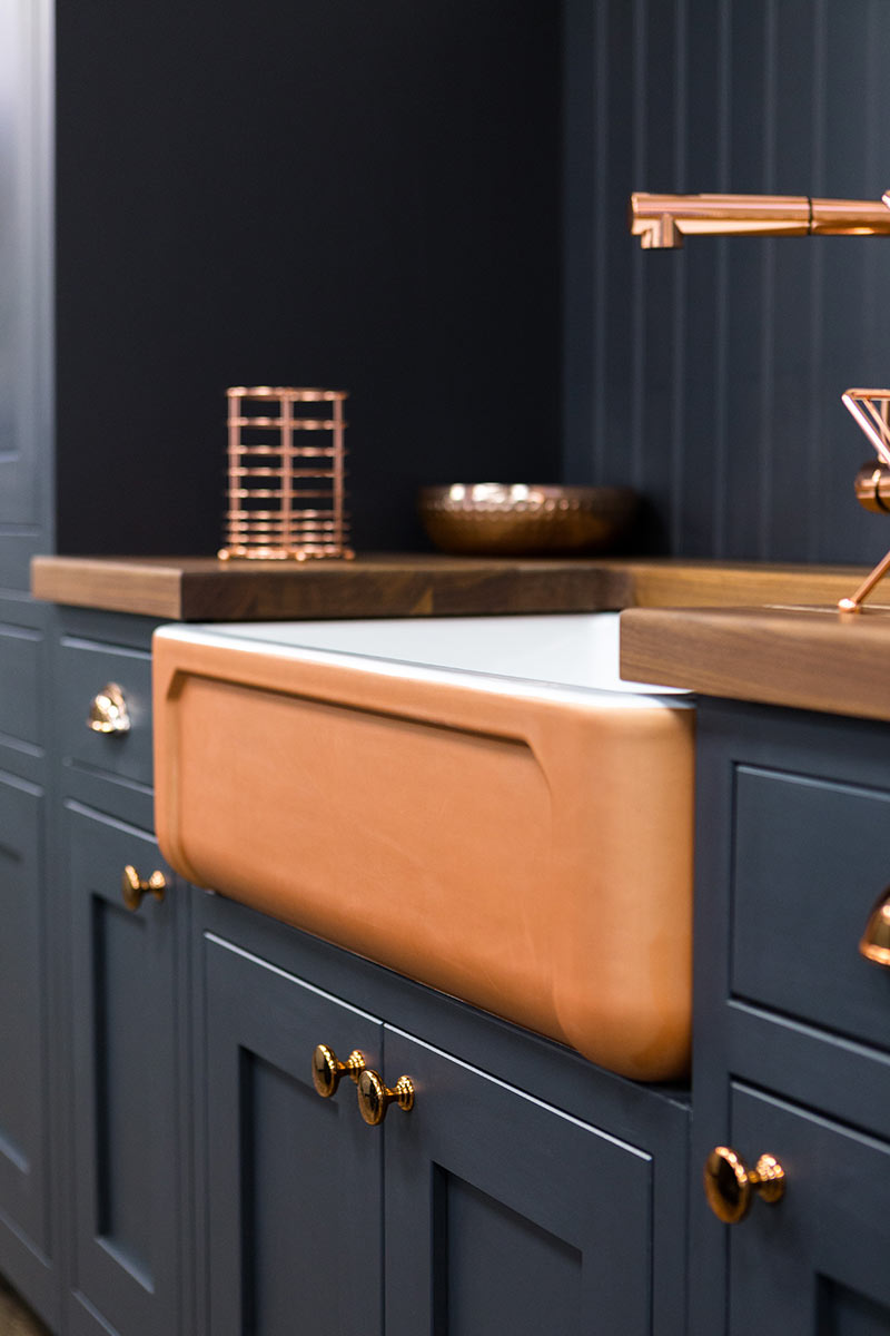 A TRADITIONAL SHAKER KITCHEN WITH A MODERN COPPER BELFAST SINK